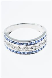 Sale 8299J - Lot 346 - AN 18CT WHITE GOLD SAPPHIRE AND DIAMOND RING; half hoop set with 7 round brilliant cut diamonds within a border of round cut blue sa...