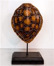 Sale 8516A - Lot 88 - A decorative faux tortoise shell mounted on an upright base. 	34cm high x 18cm wide x 11cm deep