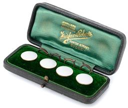 Sale 9160 - Lot 350 - A SET OF ANTIQUE 15CT GOLD ENAMELLED SHIRT STUDS; 14mm round white enamel discs set in 15ct gold, in green velvet lined Fairfax & Ro...