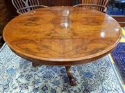Sale 8728 - Lot 1078 - Victorian Figured Walnut Supper Table, the oval top on turned and carved pedestal