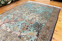 Sale 8735 - Lot 21 - A Cadrys silk Persian Garden of Paradise carpet, depicting animals in the forest against a blue ground. 160cm x 112cm