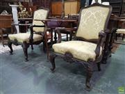 Sale 8634 - Lot 1064 - Pair of 18th Century Style Probably Carved Walnut Armchairs, upholstered in a gold brocade fabric, with outswept arms, shell carved...