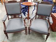 Sale 8792 - Lot 1057 - A pair of Edwardian, possibly carved mahogany armchairs of slightly graduated size, upholstered in a grey diaper fabric, raised on t...