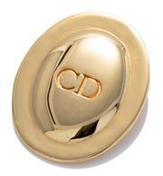 Sale 9029F - Lot 35 - A DIOR CD LOGO BROOCH; oval gilt metal brooch marked Parfums Christian Dior, size 50 x 40mm.