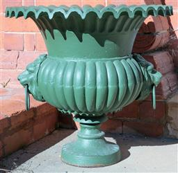 Sale 9190H - Lot 2 - An antique cast iron garden jardiniere C: 1880. The frill necked top above a melon fluted centre with 2 ringed lion mask heads onto a..
