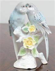 Sale 9070H - Lot 90 - A figural study of parakeets in bone china, Height 15cm