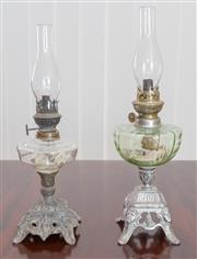 Sale 8338A - Lot 54 - Two antique small kerosene lamps with cast metals bases and glass fonts, taller 39cm