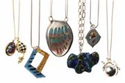 Sale 8527 - Lot 323 - SILVER PENDANT NECKLACES; 4 organic hand crafted enamel pendants, one passionfruit, all on various silver chains, and 2 Russian silv...