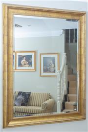Sale 8562A - Lot 76 - A large antiqued gilt framed bevel edged rectangular mirror, 145 x 115cm