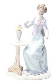 Sale 8729 - Lot 89 - Lladro Figure Of Lady Holding Flowers