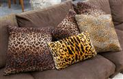 Sale 8746 - Lot 1074 - A set of five down filled cushions including leopard and tiger print examples