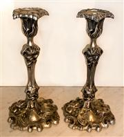 Sale 8516A - Lot 95 - A pair of nickel rococo style candlesticks. 29cm high x 17cm base width