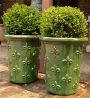 Sale 8871H - Lot 29 - A pair of tall French style glazed ceramic planters with green finish and planted with buxus, height 65, diameter 58cm (height does...