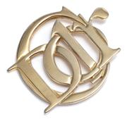 Sale 9029F - Lot 17 - A DIOR MONOGRAM BROOCH; in gilt metal marked Parfums Christian Dior, 52 x 62mm.