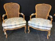 Sale 9048 - Lot 1056 - Pair of Louis XV Style Carved Beech Armchairs, with caned back, blue & cream upholstered seats with matching tie-on cushions, raised...