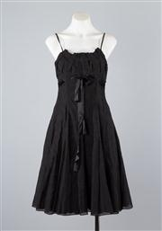 Sale 8685F - Lot 65 - An Emporio Armani black, layered sleeveless sundress woven with a subtle floral print, size UK 10
