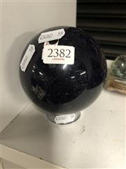 Sale 8819 - Lot 2382 - Blue Goldstone Sphere (man made with flecks of copper)