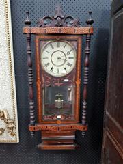 Sale 8848 - Lot 1054 - Late 19th Century American Rosewood & Marquetry Wall Clock, with Tunbridge style panels, turned columns & mirrored pendulum section