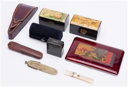 Sale 9190E - Lot 16 - A collection of trinkets including nail files