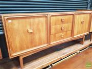 Sale 8435 - Lot 1044 - Parker Sideboard with Three Central Drawers and Two Oversized Panel Doors