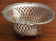 Sale 8976H - Lot 3 - An early C20th German 800 silver pierced bon bon dish raised on feet (feet slightly bent) Diameter 15cm, wt 139g
