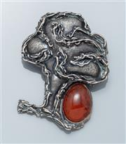 Sale 9037F - Lot 82 - A SILVER TREE MOTIF AMBER BROOCH; set with a 20 x 13mm oval reconstitued amber, size 60 x 46mm, wt. 24.48g.
