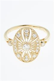 Sale 8299J - Lot 392 - AN 18CT GOLD EDWARDIAN STYLE DIAMOND RING; centring a round brilliant cut diamond of 0.12ct to pierced oval mount and shoulders set..