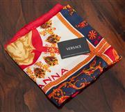 Sale 9070H - Lot 66 - A Versace silk scarf with Medusa head designed by Gianna, 87cm x 87cm