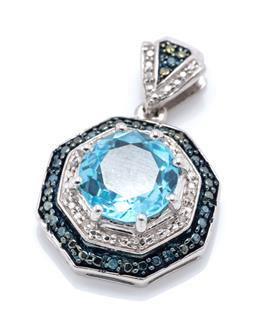 Sale 9246J - Lot 328 - A SILVER TOPAZ AND DIAMOND PENDANT; centre claw set with a round cut blue topaz to double octagonal surround and triangular bale set...