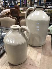 Sale 8822 - Lot 1814 - Pair of Graduating Ceramic Fowler Demijons