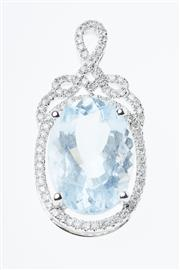 Sale 8299J - Lot 321 - AN 18CT WHITE GOLD AQUAMARINE AND DIAMOND PENDANT; featuring an oval cut light blue aquamarine of 5.27ct to scrolling surround set w...