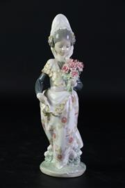 Sale 8887 - Lot 13 - Lladro Figure of a Valentina Girl Holding Flowers (H24.5cm)