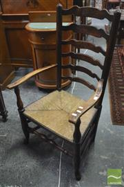 Sale 8317 - Lot 1039 - C19th Oak Provincial Ladder-Back Armchair with rush seat, turned legs & stretchers