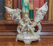 Sale 8435A - Lot 45 - A Continental porcelain bow pot with cherub perched on cornucopia, W 22cm