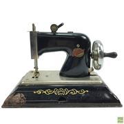 Sale 8648A - Lot 98 - Comet Miniature Sewing Machine
