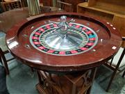 Sale 8684 - Lot 1083 - Large Roulette Wheel with Cast Alloy Centre and Timber Surround