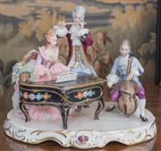 Sale 8435A - Lot 43 - A Capodimonte musical group of three musicians with piano, flute and cello on an oval base, W 28cm, crack to base