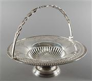 Sale 8444A - Lot 53 - A pretty antique English silverplate swing handle basket with extensive foliate and garland pierced decoration, c1910, H 21 x D 28