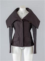 Sale 8685F - Lot 24 - A Gucci wool-blend structured jacket with exaggerated collar, size 42