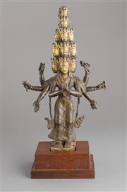 Sale 8536 - Lot 35 - 17th/18th century Tibeten partially gilded bronze eleven-headed Bodhisattva Avalokiteshvara of slender proportions, height 30cm (not...
