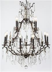 Sale 8651A - Lot 8 - A French Louis XV style bronze 12 light chandelier, with cut crystal pendants and obelisks