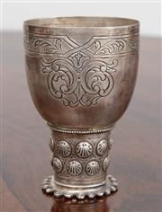 Sale 9070H - Lot 69 - A sterling silver chalice of diminutive size with shell decoration and engraved scroll work, Height 10cm