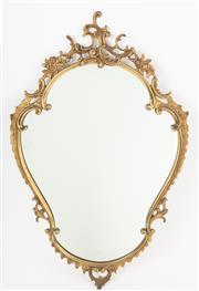 Sale 8651A - Lot 3 - An ornate Italian brass shield mirror, H 86 x W 54cm