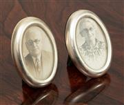 Sale 9070H - Lot 70 - A pair of oval photo frames of diminutive size in silver, Height 8cm
