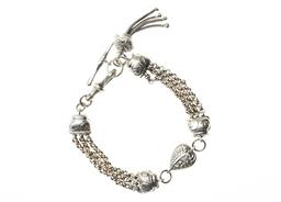 Sale 9149 - Lot 330 - A STERLING SILVER ALBERTINA BRACELET; triple strand belcher chain with a heart link, swivel clasp, T-bar and tassel, length 20.5cm,...