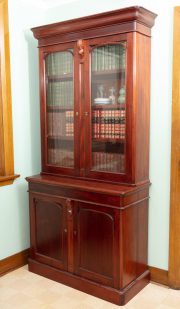 Sale 8795A - Lot 36 - A very well constructed Victorian style two part bookcase, two glazed arch doors concealing three shelves over frieze drawer, the tw...