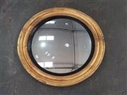 Sale 8728 - Lot 1072 - Probably Regency Gilt Framed Convex Mirror, with moulded edge and ebonised slip (Dia: 72cm, distressed)