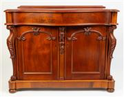 Sale 8599A - Lot 73 - An antique colonial cedar serpentine fronted sideboard c. 1850 fitted with a drawer above a foliate centre carving and two doors fla...