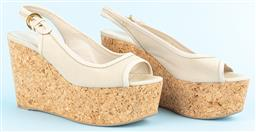 Sale 9092F - Lot 97 - A PAIR OF SERGIO ROSSI WEDGES; with peep toe, gold hardware and beige fabric. Size 37 in Dust bag.