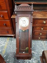 Sale 8814 - Lot 1029 - Late 19th Century American Walnut Wall Clock, probably New Haven Clock Co., with turned gallery top, two train key-wind movement, th...